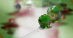 Green Marbles & Bread Crumbs on Counter, 2008